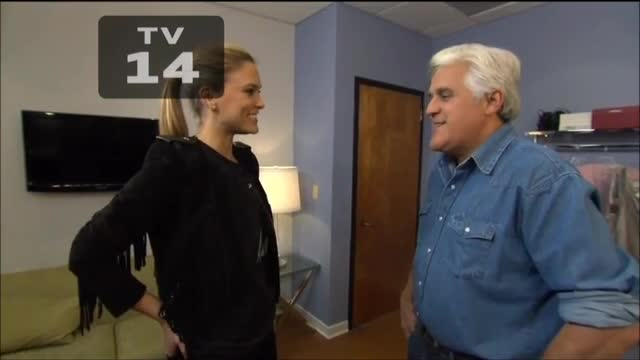 Leno Asks Model to Recreate Go Daddy Super Bowl Ad, Ends Up Kissing The Nerd